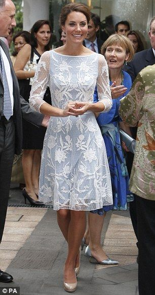 Kate, wearing an elegant ice blue lace dress by Alice Temperley
