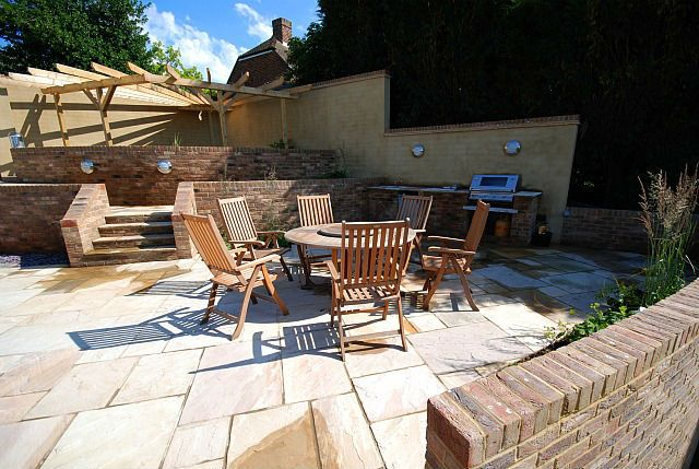 Evolving Spaces Landscape Designs LTD - A large entertainment Terrace with outdoor kitchen.