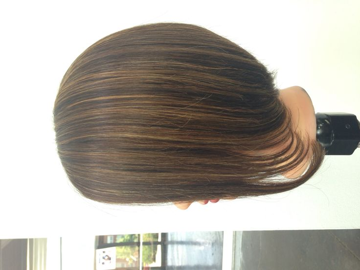 Triangle one length Bob haircut with partial highlights