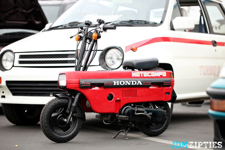 Honda Motocompo... Sweet little 49cc (2 stroke!!) designed specifically to stand up in the back hatch floor of the City Turbo. Handle bars and seat lower for storage.