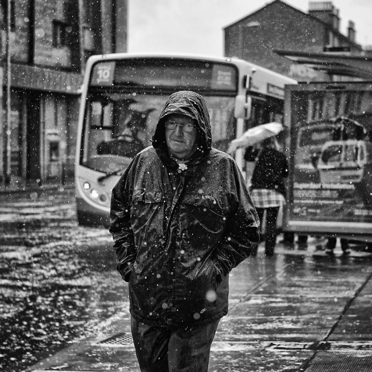 "It rains a lot in Scotland. Living in Glasgow, you get used to it - in fact it can seem strange if there's a long spell of sunny weather. I like taking pictures in the rain.  I snapped this unsuspecting pedestrian from the doorway of the Lismore bar, in Glasgow. It was in the midst of a particularly heavy downpour. The barmaid wanted to see the picture on the back of the camera, so I showed her. ""Oh, that's Tommy"", she said.  Glasgow, Scotland"