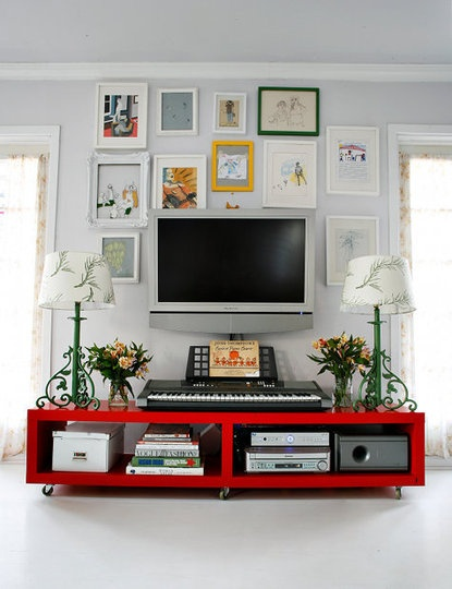 Hiding TVs In Plain View – Incorporate the TV into a salon style picture arrangement. The first time I saw this successfully employed, and it was so effective visually that now I employ it in nearly every home I help to decorate. Surrounded by pieces of art with similar shape or size frames, the TV blends into the background rather than dominating the wall.