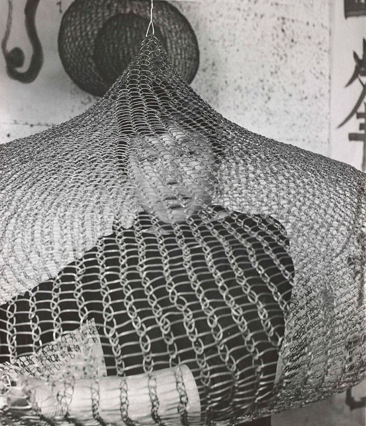 Ruth Asawa working inside on one of her crocheted wire sculptures | 1957 | Photo by Imogen Cunningham