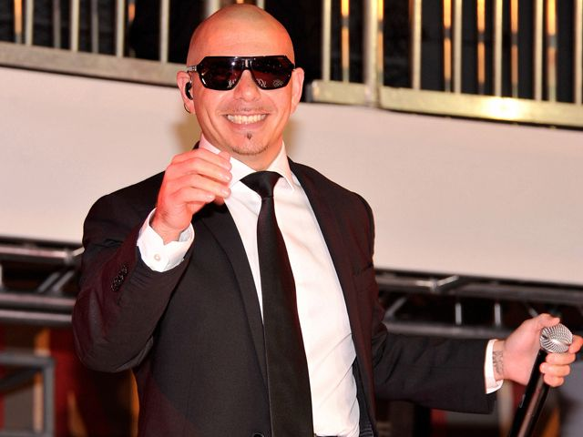 "pitbull the singer pictures | NEW YORK, NY - MAY 23: Singer Pitbull performs at the ""Men In Black 3 ..."