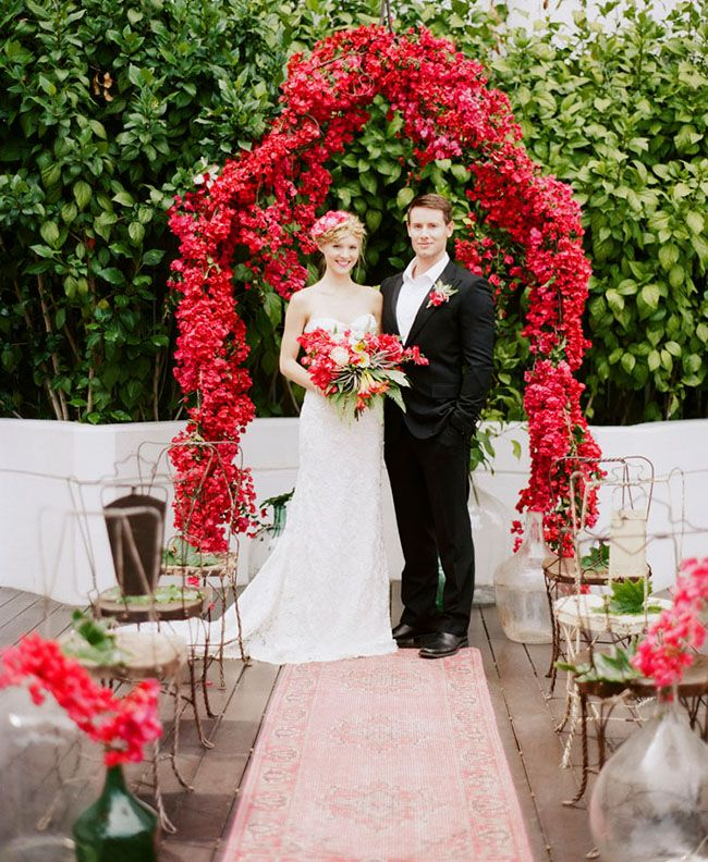 Love the use of Bougainvillea in this beautiful ceremony set-up