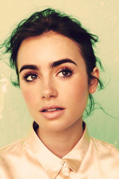 Lily Collins is the poster child for bold eyebrows in Hollywood. And she isn't afraid to leave the tweezers alone.:
