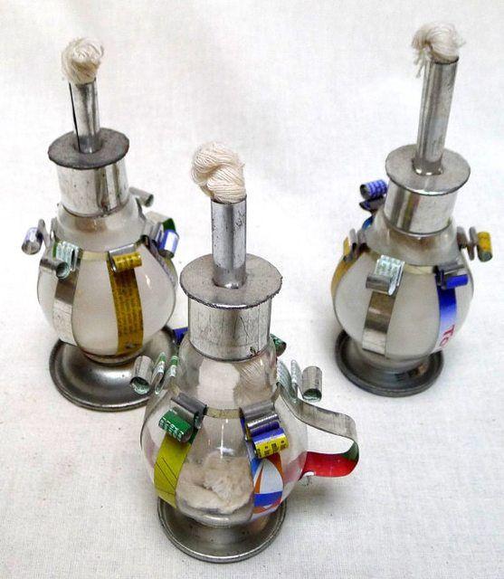lampade ad olio africane fatte con lampadine vecchie
