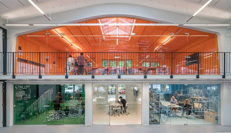 MVRDV has moved into a new studio in Rotterdam, featuring multicoloured meeting rooms, a plant-covered chandelier and a staircase that doubles as seating
