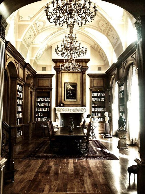 Awesome and elaborate library that could be a dining room. Beautiful built-ins and ceiling....