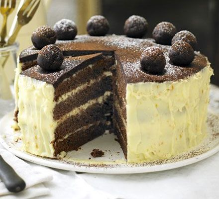 Chocolate, orange and almond simnel cake. A rich, indulgent Easter treat with orange frosting and homemade chocolate marzipan, great for those who don't like traditional fruit cake