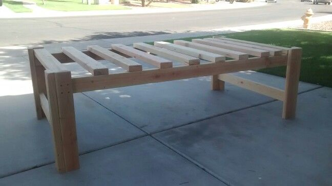 "Simple twin bed frame w/ room for storage bins underneath. Material list: Nine - 2x4s 2 1/2"" screws Wood glue  Cut list 8 - 23.5"" 2x4 10 - 38.5"" 2x4 2 - 75"" 2x4"