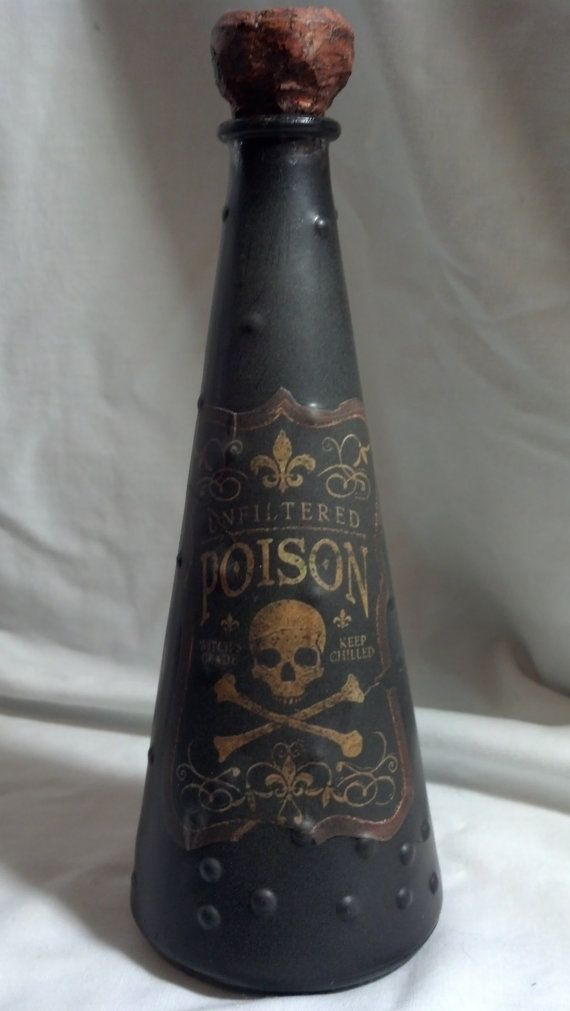"Up-cycled glass bottle turned creepy Halloween decor!  ""Poison"", skull and crossbones vessel to add to your potion bottle collection."
