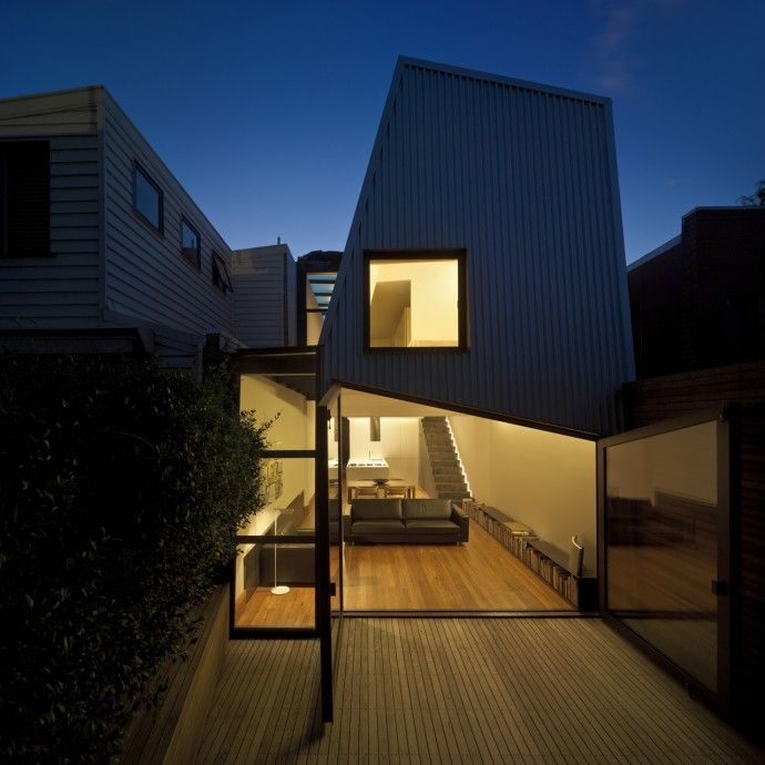 One of our favourite small footprint residential projects in Melbourne is the Law Street House, lovingly built by the hands of owner-architects, Bruno Mendes and Amy Muir of Muir Mendes. A poker-faced steel façade conceals the second storey within a cleverly-angled roof pitch. Clean and contemporary while retaining the quintessential 'houseness' of the site's former Victorian worker's cottage.
