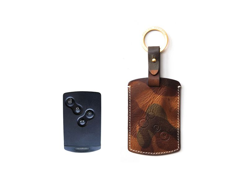 Samsung Handmade Buttero Leather Smart Key Cover/Case   -Handmade by: Custom Republic  -Leather: Vegetable leather from Conceria Walpier & Vera Pelle -Attachment pieces: 18K gold satin coating - Colors: natural, yellow, orange, brown, navy, and camouflage -Thread & Stitching: Serafil (from Germany)  -Measurement: 6.8cm x 17cm