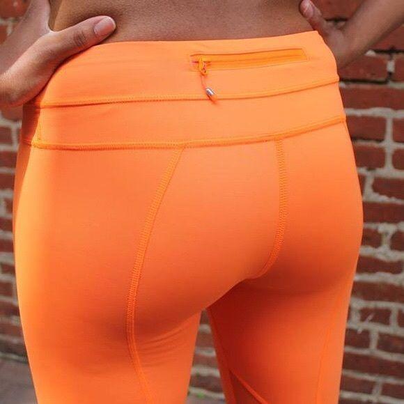 Lululemon Bright Orange Run-Time Pants - fitted orange leggings with zipper pocket on back, great for running lululemon athletica Pants Leggings