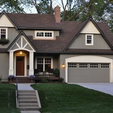 Benjamin Moore Copley Gray (HC-104) trimmed with BM Elephant Tusk (OC-8).        8 Exterior Paint Colors That Might Help Sell Your House