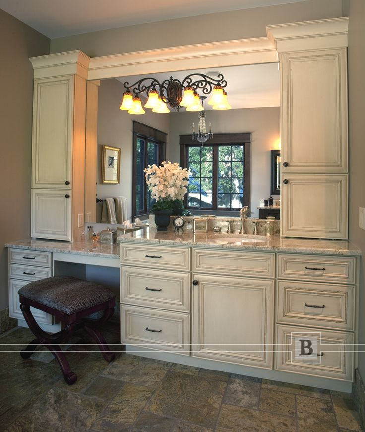 Master bath make-up area with painted cabinets. Traditional cabinetry with wall cabinets.