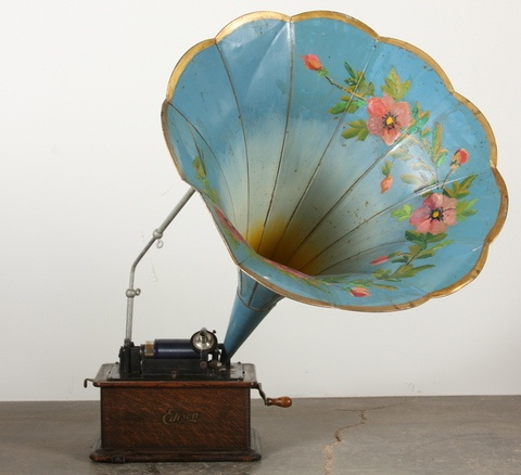 """(Not quite Victorian, but close) ........   """"An early 20th century Edison Standard Phonograph in and oak case with a petal-style metal horn that has been painted blue with a ring of pink flowers to the inside.. This piece plays cylinder style recordings and includes 14 of various titles."""""""