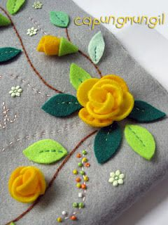 This felt flower with beads and embroidery project is so beautiful. Neat idea to use semi circles of waste felt for rose petals.