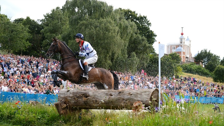 William Fox-Pitt of Great Britain riding Lionheart jumps across a log in the Eventing Cross Country Equestrian event on Day 3 of the London 2012 Olympic Games at Greenwich Park.