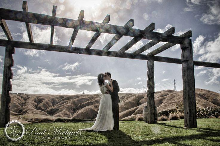 Bride and groom kiss at Ohariu farm wedding. New Zealand #wedding #photography. PaulMichaels of Wellington http://www.paulmichaels.co.nz/