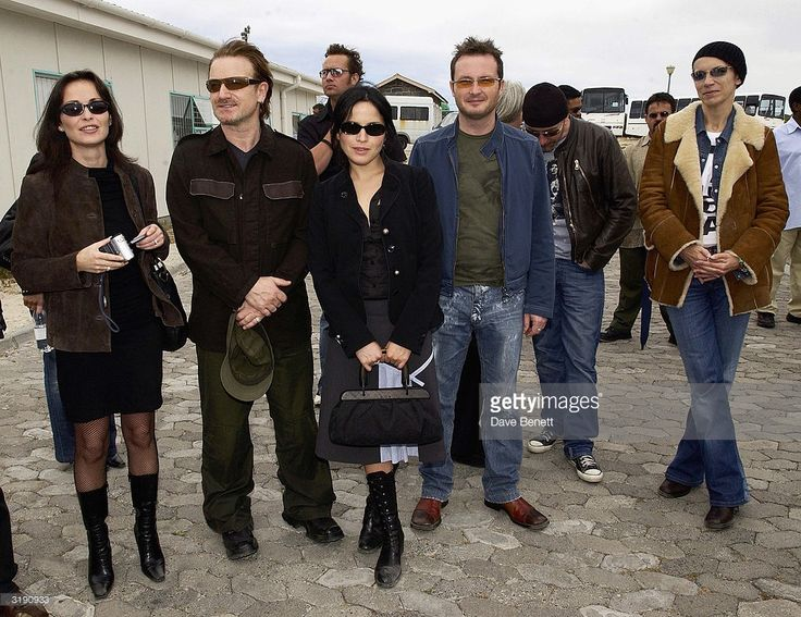 British pop stars Andrea Corr, Caroline Corr, Jim Corr, The Edge, Bono and Annie Lennox visit Nelson Mandela's former prison cell on Robben Island where Nelson Mandela was imprisoned on November 28, 2003 in Cape Town, South Africa.