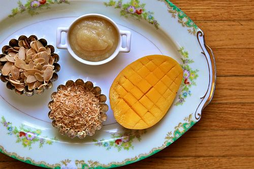 ... – Breakfast Quinoa with toasted coconut, almonds, and fresh mango