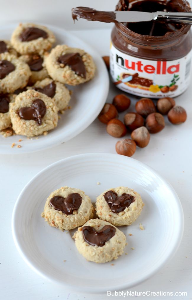 Nutella Cookies! Hazelnut thumbprint cookies filled with Nutella! So ...