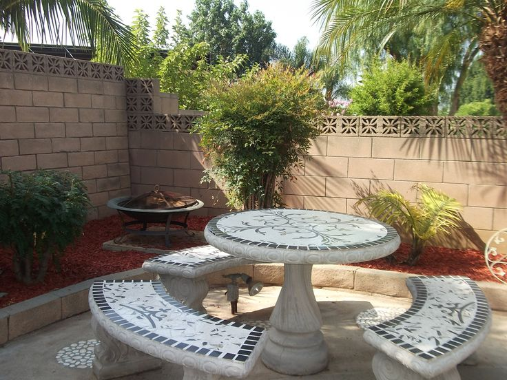 Fire pit, tile and concrete sitting area