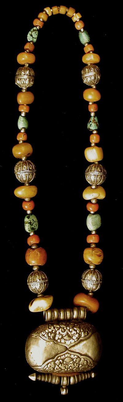 A large antique silver Tibetan Ghao box suspended on a length of antique Tibetan Amber, antique Tibetan Coral, antique Tibetan Turquoise, and Antique Yemen silver balls. Designed by Seemanta