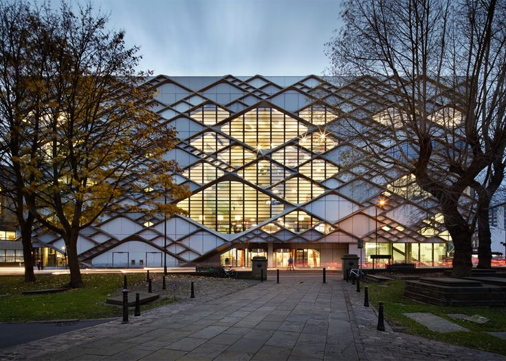 Aluminium lattice covering the facades of this university building in Sheffield, England, incorporates windows of varying sizes