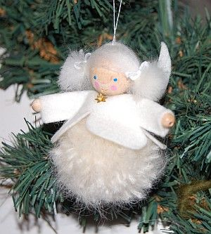 Pompom Winterelfe.  Pompom Little Angel   (Little Troll).   A small Pompompüppchen of wool and felt. The head is a (unpainted) wooden bead.  Also very nice over the winter table!