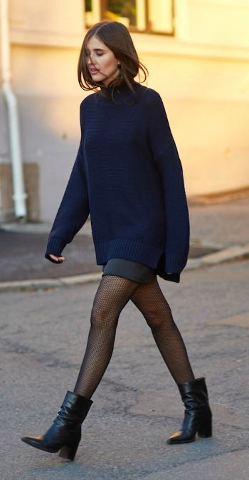 Darja Barannik + the black and blue trend + navy sweater + black mini skirt + leather boots + cosy winter style   Brands not specified.