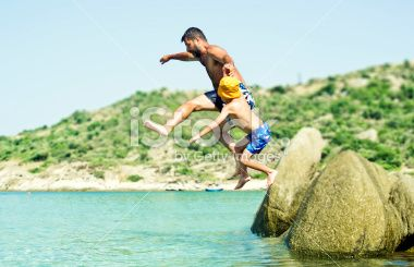 Jumping to the sea Royalty Free Stock Photo