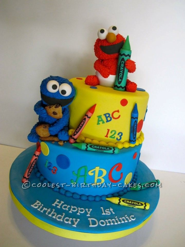 1st Birthday Cake with Baby Elmo and Cookie Monster... This website is the Pinterest of birthday cake ideas