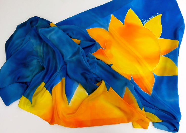 Simple, blue variation of purple sunflower scarf. Made for more summery feel, it uses two colours closely asscociated with that period - bright, hot yellow for sun/sunflower (interchangeable with me, at least in my art) and blue for water balancing it. Blue is painted in the way to resemble water reflecting shimmering light on its surface. It is a big scarf (90 x 180 cm) with added personal flair, name close to petal of sunflower. Perfect summer scarf to where it was shipped to.
