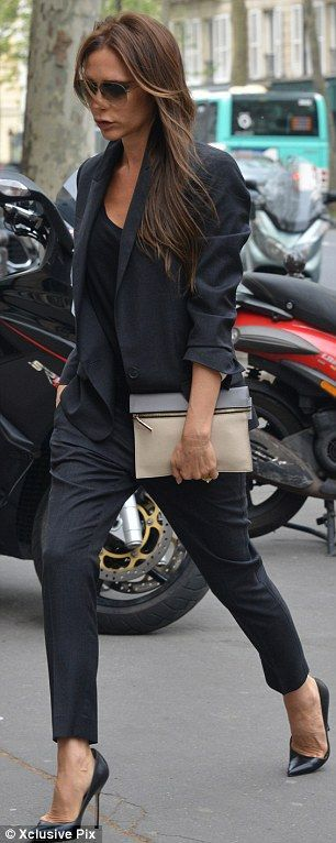 Dressed to kill: Victoria looked chic in her all-black outfit of a trouser suit and heels
