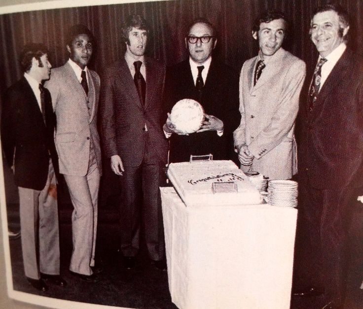 Awaiting a slice of cake after Geoff Hurst's testimonial in November 1971 are Uwe Seeler,  Eusebio, Geoff Hurst, Philip Isaacs, Mordechai Spiegler and Morris.