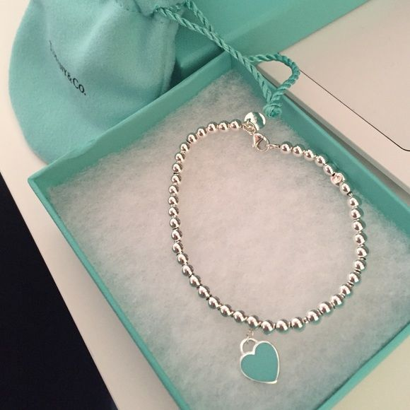 "Tiffany & Co. Return to Tiffany bead bracelet ***this item will not drop below $100. If you want it please make official offer.*** Size small, 6.5 inches bracelet length, beads are 4 mm, one side of the heart is the Tiffany blue, the other side is the classic ""please return to Tiffany & co."" It does have two beads that look a little smushed, it came like that! It is not noticeable when wearing. Only been worn twice, recently professional cleaned by Tiffany &co! Like new! Comes with box…"