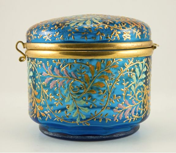 A gorgeous late 19th to early 20th century Art Nouveau hinged dresser box by Moser.  In beautiful condition with continuous fall foliage enamel and gilt decor still bright and whole after all these years. Unusual shape in a round straight-sided box with domed lid.