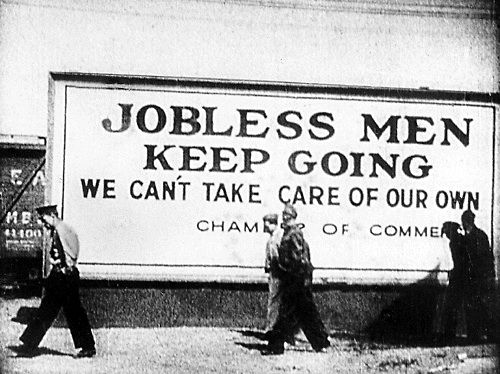 best the great depression era images dust bowl the great depression in this picture the board s caption shows jobless men keep going and there are exactly people walking in front the board