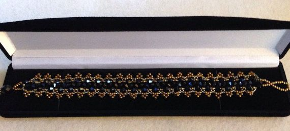 Beautiful Black And Gold Beaded Bracelet made by ForgivenMuse for sale on Etsy.