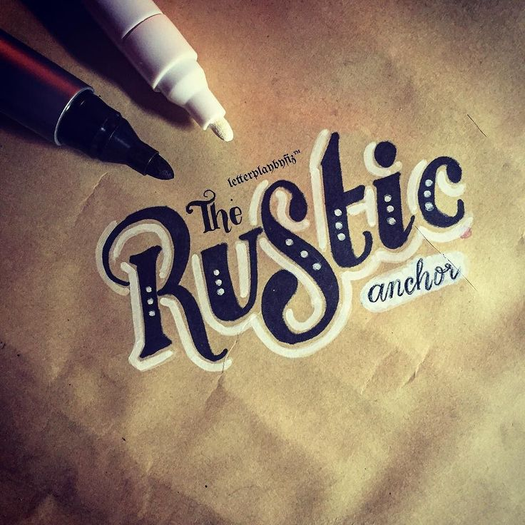 """The Rustic Anchor."" Handdrawn vintage-style lettering on brown paper."