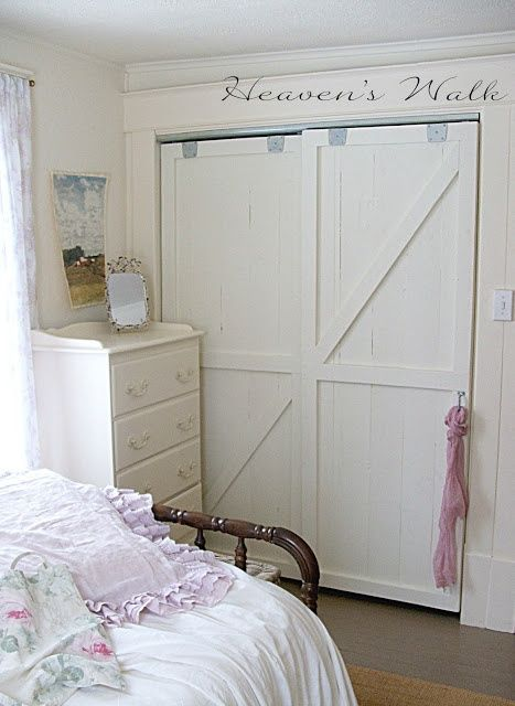 OMG, I have these exact doors and I'm planning to use them in my son's room.   ***Sliding barn doors -  installed two simple by-pass closet door track systems purchased at Home Depot for about $15 each. - from http://heavens-walk.blogspot.com/2013/02/shabby-prairie-chic-remodel.html