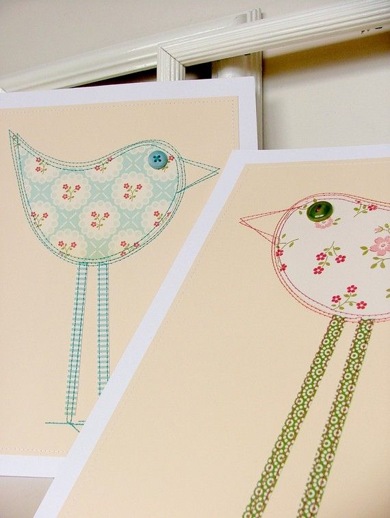 The birds are made from different patterned papers that have been cut out by hand, glued and then machine stitched onto background cards. Button eyes sewn on by hand and finally mounted on a nice, crisp white card stock with a machine stitched border in white thread.