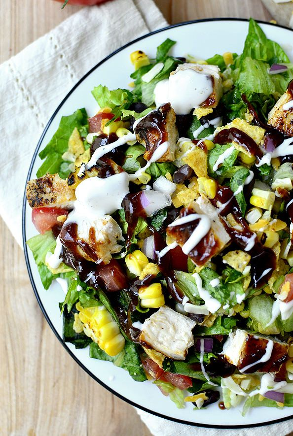 BBQ Chicken Chopped Salad with tomato, grilled corn, crushed tortilla chips, and Monterey Jack cheese