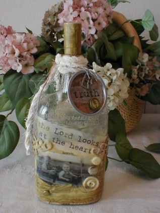 altered art bottle. i would like this on my plant shelves.