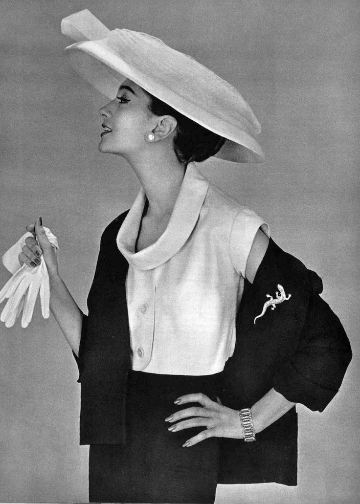 Model in white bolero worn under a black woolen jacket by Lanvin-Castillo, hat by Legroux, jewelry by Marcasite, photo by Philippe Pottier, 1956