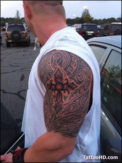 Man Left Half Sleeve Red And Black Tribal Cross Tattoo