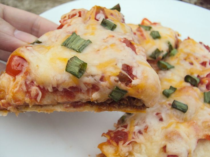 Copy Taco Bell Mexican Pizza        1 lb. ground beef      3 Tbsp. taco seasoning      1/4 c. water      vegetable oil, for frying      12 flour tortillas      16 oz. can refried beans      3/4 c. salsa      1 large tomato, diced      1 1/2 c. taco cheese      1/2 c. green onion, diced    Preheat oven to 400 degrees. Brown ground beef in skillet over medium-high until no longer pink, drain. Add taco seasoning and water, bring to a boil. Reduce heat to low and simmer 3-5 minutes.    Heat…